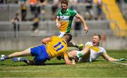 24 June 2018; Eoin Cleary of Clare in action against Alan Mulhall of Offaly during the GAA Football All-Ireland Senior Championship Round 2 match between Offaly and Clare at Bord Na Mona O'Connor Park in Tullamore, Offaly. Photo by Harry Murphy/Sportsfile