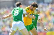 24 June 2018; Odhran MacNiallais of Donegal is tackled by Eoin Donnelly of Fermanagh during the Ulster GAA Football Senior Championship Final match between Donegal and Fermanagh at St Tiernach's Park in Clones, Monaghan. Photo by Ramsey Cardy/Sportsfile