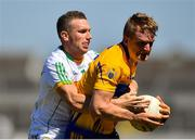 24 June 2018; Pearse Lillis of Clare in action against Anton Sullivan of Offaly during the GAA Football All-Ireland Senior Championship Round 2 match between Offaly and Clare at Bord Na Mona O'Connor Park in Tullamore, Offaly. Photo by Harry Murphy/Sportsfile