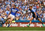 24 June 2018; Donal Kingston of Laois scores a first half point under pressure from Jonny Cooper of Dublin during the Leinster GAA Football Senior Championship Final match between Dublin and Laois at Croke Park in Dublin. Photo by Piaras Ó Mídheach/Sportsfile