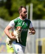 24 June 2018; Fermanagh's Sean Quigley takes a dog off the pitch during the Ulster GAA Football Senior Championship Final match between Donegal and Fermanagh at St Tiernach's Park in Clones, Monaghan. Photo by Philip Fitzpatrick/Sportsfile