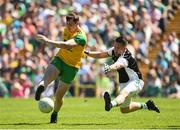 24 June 2018; Jamie Brennan of Donegal has his shot blocked by Patrick Cadden of Fermanagh  during the Ulster GAA Football Senior Championship Final match between Donegal and Fermanagh at St Tiernach's Park in Clones, Monaghan. Photo by Oliver McVeigh/Sportsfile