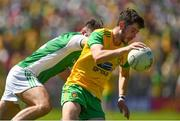 24 June 2018; Ryan McHugh of Donegal in action against Kane Connor of Fermanagh during the Ulster GAA Football Senior Championship Final match between Donegal and Fermanagh at St Tiernach's Park in Clones, Monaghan. Photo by Philip Fitzpatrick/Sportsfile