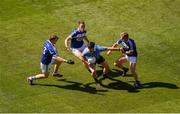 24 June 2018; Michael Darragh MacAuley of Dublin in action against Laois players, left to right, Mark Timmons, John O'Loughlin, and Damien O'Connor during the Leinster GAA Football Senior Championship Final match between Dublin and Laois at Croke Park in Dublin. Photo by Daire Brennan/Sportsfile