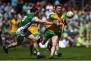 24 June 2018; Leo McLoone of Donegal in action against Eoin Donnelly of Fermanagh during the Ulster GAA Football Senior Championship Final match between Donegal and Fermanagh at St Tiernach's Park in Clones, Monaghan. Photo by Ramsey Cardy/Sportsfile