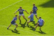 24 June 2018; Con O'Callaghan of Dublin in action against Laois players, left to right, Trevor Collins, John O'Loughlin, and Damien O'Connor during the Leinster GAA Football Senior Championship Final match between Dublin and Laois at Croke Park in Dublin. Photo by Daire Brennan/Sportsfile
