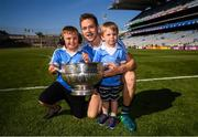 24 June 2018; Dublin's Dean Rock with his cousin Matthew Rock, left, and nephew Eli D'Arcy and the Delaney Cup following the Leinster GAA Football Senior Championship Final match between Dublin and Laois at Croke Park in Dublin. Photo by Stephen McCarthy/Sportsfile