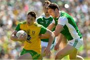 24 June 2018; Jamie Brennan of Donegal is tackled by Eoin Donnelly of Fermanagh during the Ulster GAA Football Senior Championship Final match between Donegal and Fermanagh at St Tiernach's Park in Clones, Monaghan. Photo by Ramsey Cardy/Sportsfile