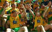 24 June 2018; Hugh McFadden and Michael Langan lift the trophy alongside their Donegal team-mates following the Ulster GAA Football Senior Championship Final match between Donegal and Fermanagh at St Tiernach's Park in Clones, Monaghan. Photo by Ramsey Cardy/Sportsfile