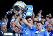24 June 2018; Paddy Andrews of Dublin lifts the Delaney Cup following the Leinster GAA Football Senior Championship Final match between Dublin and Laois at Croke Park in Dublin. Photo by Stephen McCarthy/Sportsfile
