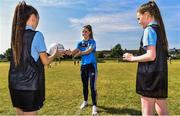 27 June 2018; Aoife Kane of Dublin, centre, passes a ball with Halle McDonald, left, and Kim Ellis, both aged 12, and both from St Raphaels, Ballyfermot, all were in Ballyfermot Sports Complex today at the AIG Heroes event, an initiative which helps support local grassroots communities by partnering with Dublin GAA and others to use sport as a means to build self-confidence and social skills in young kids. To further promote these efforts AIG Insurance gifted GAA equipment to primary schools in the area. Photo by Sam Barnes/Sportsfile