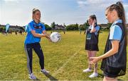 27 June 2018; Aoife Kane of Dublin, left, passes a ball to Halle McDonald, right, with Kim Ellis, centre, both aged 12, and both from St Raphaels, Ballyfermot, all were in Ballyfermot Sports Complex today at the AIG Heroes event, an initiative which helps support local grassroots communities by partnering with Dublin GAA and others to use sport as a means to build self-confidence and social skills in young kids. To further promote these efforts AIG Insurance gifted GAA equipment to primary schools in the area. Photo by Sam Barnes/Sportsfile