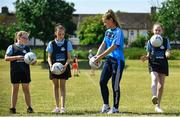 27 June 2018; Aoife Kane of Dublin was with pupils from St Raphaels, Ballyfermot, from left, Bronagh Redmond, Halle McDonald and Kim Ellis, all aged 12, they were pictured in Ballyfermot Sports Complex today at the AIG Heroes event, an initiative which helps support local grassroots communities by partnering with Dublin GAA and others to use sport as a means to build self-confidence and social skills in young kids. To further promote these efforts AIG Insurance gifted GAA equipment to primary schools in the area. Photo by Sam Barnes/Sportsfile
