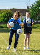 27 June 2018; Aoife Kane of Dublin, and Kim Ellis, aged 12, from St Raphaels, Ballyfermot, were pictured in Ballyfermot Sports Complex today at the AIG Heroes event, an initiative which helps support local grassroots communities by partnering with Dublin GAA and others to use sport as a means to build self-confidence and social skills in young kids. To further promote these efforts AIG Insurance gifted GAA equipment to primary schools in the area. Photo by Sam Barnes/Sportsfile