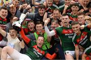 17 June 2018; Mayo players celebrate with the cup after the EirGrid Connacht GAA Football U20 Championship Final match between Mayo and Roscommon at Dr Hyde Park in Roscommon. Photo by Piaras Ó Mídheach/Sportsfile