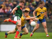17 June 2018; Jordan Flynn of Mayo in action against Aidan Dowd of Roscommon during the EirGrid Connacht GAA Football U20 Championship Final match between Mayo and Roscommon at Dr Hyde Park in Roscommon. Photo by Piaras Ó Mídheach/Sportsfile