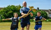 27 June 2018; Fergal Whitely of Dublin, centre, along with Michael Gaffney, aged 9, left, from St Gabriels, Ballyfermot, and Jake O'Connor, age 10, from Mary Queen of Angels, Ballyfermot, all were in Ballyfermot Sports Complex today at the AIG Heroes event, an initiative which helps support local grassroots communities by partnering with Dublin GAA and others to use sport as a means to build self-confidence and social skills in young kids. To further promote these efforts AIG Insurance gifted GAA equipment to primary schools in the area. Photo by Sam Barnes/Sportsfile