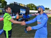 29 June 2018; Captains Gary Wilson of Ireland and Virat Kohli of India shake hands following the T20 International match between Ireland and India at Malahide Cricket Club Ground in Dublin. Photo by Seb Daly/Sportsfile