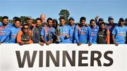 29 June 2018; India players and staff celebrate with the trophy following the T20 International match between Ireland and India at Malahide Cricket Club Ground in Dublin. Photo by Seb Daly/Sportsfile