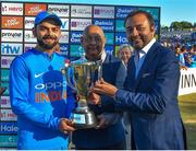 29 June 2018; Virat Kohli of India is presented with the winning trophy by Amitabh Choudhary, centre, Secretary BCCA, and Pradeep Dadha, right, Founder and CEO Netmeds, following his side's victory during the T20 International match between Ireland and India at Malahide Cricket Club Ground in Dublin. Photo by Seb Daly/Sportsfile
