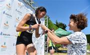 30 June 2018; Sophie O'Sullivan of Ballymore Cobh A.C., Co. Cork, is presented with her silver medal by her mother, Sonia O'Sullivan, after competing in the Junior Women 800m event   during the Irish Life Health National Junior & U23 T&F Championships at Tullamore Harriers Stadium in Tullamore, Offaly. Photo by Sam Barnes/Sportsfile