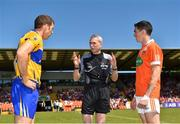 30 June 2018; Referee Fergal Kelly with captains Gary Brennan of Clare and Rory Grugan of Armagh during the coin toss prior to the GAA Football All-Ireland Senior Championship Round 3 match between Armagh and Clare at the Athletic Grounds in Armagh. Photo by Seb Daly/Sportsfile