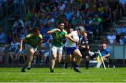 30 June 2018; Conor McCarthy of Monaghan in action against Shane Quinn, left, and Noel Plunkett of Leitrim during the GAA Football All-Ireland Senior Championship Round 3 match between Leitrim and Monaghan at Páirc Seán Mac Diarmada in Carrick-on-Shannon, Leitrim. Photo by Daire Brennan/Sportsfile