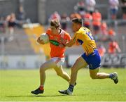 30 June 2018; Andrew Murnin of Armagh in action against Jamie Malone of Clare during the GAA Football All-Ireland Senior Championship Round 3 match between Armagh and Clare at the Athletic Grounds in Armagh. Photo by Seb Daly/Sportsfile