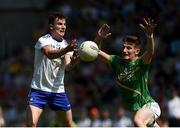 30 June 2018; Thomas Kerr of Monaghan in action against Shane Quinn of Leitrim during the GAA Football All-Ireland Senior Championship Round 3 match between Leitrim and Monaghan at Páirc Seán Mac Diarmada in Carrick-on-Shannon, Leitrim. Photo by Daire Brennan/Sportsfile
