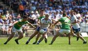 30 June 2018; Dessie Ward of Monaghan in action against Shane Quinn, left, and James Mitchell, and Michael McWeeney of Leitrim during the GAA Football All-Ireland Senior Championship Round 3 match between Leitrim and Monaghan at Páirc Seán Mac Diarmada in Carrick-on-Shannon, Leitrim. Photo by Daire Brennan/Sportsfile