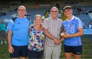30 June 2018; Michelle and Karl Swan look on as  Paul Dempsey, ESB Manager at the Electric Ireland GAA Minor Championships, presents Dublin's Luke Swan with the Player of the Match award for his major performance in the Electric Ireland GAA Leinster Minor Hurling Championship Final match between Dublin and Kilkenny at O'Moore Park in Portlaoise, Laois. Throughout the Championships, fans can follow the conversation, vote for their player of the week, support the Minors and be a part of something major through the hashtag #GAAThisIsMajor. Photo by Ray McManus/Sportsfile