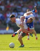 30 June 2018; Matthew Donnelly of Tyrone in action against Cian Mackey of Cavan during the GAA Football All-Ireland Senior Championship Round 3 match between Cavan and Tyrone at Brewster Park in Enniskillen, Fermanagh. Photo by Eóin Noonan/Sportsfile