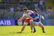 30 June 2018; Matthew Donnelly of Tyrone is tackled by Killian Brady of Cavan during the GAA Football All-Ireland Senior Championship Round 3 match between Cavan and Tyrone at Brewster Park in Enniskillen, Fermanagh. Photo by Eóin Noonan/Sportsfile