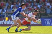 30 June 2018; Matthew Donnelly of Tyrone is tackled by Sean McCormack of Cavan during the GAA Football All-Ireland Senior Championship Round 3 match between Cavan and Tyrone at Brewster Park in Enniskillen, Fermanagh. Photo by Eóin Noonan/Sportsfile
