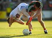 30 June 2018; Paul Cribbin of Kildare is tackled by Diarmuid O'Connor of Mayo during the GAA Football All-Ireland Senior Championship Round 3 match between Kildare and Mayo at St Conleth's Park in Newbridge, Kildare. Photo by Piaras Ó Mídheach/Sportsfile
