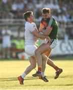 30 June 2018; Aidan O'Shea of Mayo is tackled by Niall Kelly of Kildare during the GAA Football All-Ireland Senior Championship Round 3 match between Kildare and Mayo at St Conleth's Park in Newbridge, Kildare. Photo by Piaras Ó Mídheach/Sportsfile