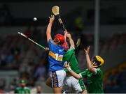 1 July 2018; Devon Ryan of Tipperary in action against Michael Keane and Padraig Harnett of Limerick during the Electric Ireland Munster GAA Hurling Minor Championship Final match between Limerick and Tipperary at Semple Stadium in Thurles, Tipperary. Photo by Ray McManus/Sportsfile