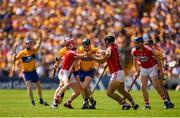 1 July 2018; Tony Kelly of Clare is tackled by Daniel Kearney, left, and Christopher Joyce of Cork during the Munster GAA Hurling Senior Championship Final match between Cork and Clare at Semple Stadium in Thurles, Tipperary. Photo by Eóin Noonan/Sportsfile