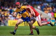 1 July 2018; John Conlon of Clare in action against Colm Spillane of Cork during the Munster GAA Hurling Senior Championship Final match between Cork and Clare at Semple Stadium in Thurles, Tipperary. Photo by David Fitzgerald/Sportsfile