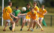 1 July 2018; Eoin Devlin of Clonduff GAC, Co Down, in action against Cael Sullivan of Donaghmore/Ashbourne, Co Meath, during the John West Féile Peil na nÓg National Competitions 2018 match between Donaghmore/Ashbourne and Clonduff GAC at Stamullen GAA in Meath. This is the third year that the Féile na nGael and Féile Peile na nÓg have been sponsored by John West, one of the world's leading suppliers of fish. The competition gives up-and-coming GAA superstars the chance to participate and play in their respective Féile tournament, at a level which suits their age, skills and strengths. Photo by Harry Murphy/Sportsfile