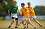 1 July 2018; Evan McConville of Clonduff GAC, Co Down, in action against Joshua Lancaster of Donaghmore/Ashbourne, Co Meath, during the John West Féile Peil na nÓg National Competitions 2018 match between Donaghmore/Ashbourne and Clonduff GAC at Stamullen GAA in Meath. This is the third year that the Féile na nGael and Féile Peile na nÓg have been sponsored by John West, one of the world's leading suppliers of fish. The competition gives up-and-coming GAA superstars the chance to participate and play in their respective Féile tournament, at a level which suits their age, skills and strengths. Photo by Harry Murphy/Sportsfile