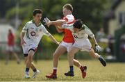 1 July 2018; John Lavery of ODonovan Rossa GAC in action against Rory McCormack, left, and Ian Kavanagh of New York during the John West Féile Peil na nÓg National Competitions 2018 match between ODonovan Rossa GAC and New York at Stamullen GAA in Meath. This is the third year that the Féile na nGael and Féile Peile na nÓg have been sponsored by John West, one of the world's leading suppliers of fish. The competition gives up-and-coming GAA superstars the chance to participate and play in their respective Féile tournament, at a level which suits their age, skills and strengths. Photo by Harry Murphy/Sportsfile