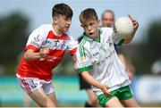 1 July 2018; Cian Cunningham of Burren GAC in action against Odhran Crozier of O Donovan Rossa GAC during the John West Féile Peil na nÓg National Competitions 2018 match between Burren GAC and O Donovan Rossa GAC at Stamullen GAA in Meath. This is the third year that the Féile na nGael and Féile Peile na nÓg have been sponsored by John West, one of the world's leading suppliers of fish. The competition gives up-and-coming GAA superstars the chance to participate and play in their respective Féile tournament, at a level which suits their age, skills and strengths. Photo by Harry Murphy/Sportsfile
