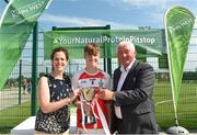 1 July 2018; Conall Higgins of O Donovan Rossa GAC is presented their Boys Division 1 Cup by Anne-Claire Monde Marketing Manager of John West and Brendan Brien Chairman of National Féile during the John West Féile Peil na nÓg National Competitions 2018 match between Burren GAC and O Donovan Rossa GAC at Stamullen GAA in Meath. This is the third year that the Féile na nGael and Féile Peile na nÓg have been sponsored by John West, one of the world's leading suppliers of fish. The competition gives up-and-coming GAA superstars the chance to participate and play in their respective Féile tournament, at a level which suits their age, skills and strengths. Photo by Harry Murphy/Sportsfile