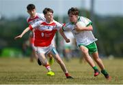 1 July 2018; Michael Murdock of O Donovan Rossa GAC in action against Aaron Murray of Burren GAC during the John West Féile Peil na nÓg National Competitions 2018 match between Burren GAC and O Donovan Rossa GAC at Stamullen GAA in Meath. This is the third year that the Féile na nGael and Féile Peile na nÓg have been sponsored by John West, one of the world's leading suppliers of fish. The competition gives up-and-coming GAA superstars the chance to participate and play in their respective Féile tournament, at a level which suits their age, skills and strengths. Photo by Harry Murphy/Sportsfile