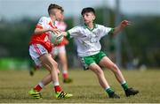 1 July 2018; James Murray of O Donovan Rossa GAC in action against Donagh Murdock of Burren GAC during the John West Féile Peil na nÓg National Competitions 2018 match between Burren GAC and O Donovan Rossa GAC at Stamullen GAA in Meath. This is the third year that the Féile na nGael and Féile Peile na nÓg have been sponsored by John West, one of the world's leading suppliers of fish. The competition gives up-and-coming GAA superstars the chance to participate and play in their respective Féile tournament, at a level which suits their age, skills and strengths. Photo by Harry Murphy/Sportsfile
