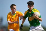 1 July 2018; Jack Conway of Claregalway in action against Conor Quinn of Clonduff GAC during the John West Féile Peil na nÓg National Competitions 2018 match between Claregalway and Clonduff GAC at Stamullen GAA in Meath. This is the third year that the Féile na nGael and Féile Peile na nÓg have been sponsored by John West, one of the world's leading suppliers of fish. The competition gives up-and-coming GAA superstars the chance to participate and play in their respective Féile tournament, at a level which suits their age, skills and strengths. Photo by Harry Murphy/Sportsfile
