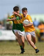 1 July 2018; Eoghan McAlinden of Clonduff GAC in action against Jack Buckley of Claregalway during the John West Féile Peil na nÓg National Competitions 2018 match between Claregalway and Clonduff GAC at Stamullen GAA in Meath. This is the third year that the Féile na nGael and Féile Peile na nÓg have been sponsored by John West, one of the world's leading suppliers of fish. The competition gives up-and-coming GAA superstars the chance to participate and play in their respective Féile tournament, at a level which suits their age, skills and strengths. Photo by Harry Murphy/Sportsfile