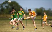 1 July 2018; Senan Carr of Clondduff GAC kicks a point under pressure from Ryan Kearney of Claregalway during the John West Féile Peil na nÓg National Competitions 2018 match between Claregalway and Clonduff GAC at Stamullen GAA in Meath. This is the third year that the Féile na nGael and Féile Peile na nÓg have been sponsored by John West, one of the world's leading suppliers of fish. The competition gives up-and-coming GAA superstars the chance to participate and play in their respective Féile tournament, at a level which suits their age, skills and strengths. Photo by Harry Murphy/Sportsfile