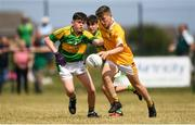 1 July 2018; Eoghan McAlinden of Clonduff GAC in action against Ryan Kearney of Claregalway during the John West Féile Peil na nÓg National Competitions 2018 match between Claregalway and Clonduff GAC at Stamullen GAA in Meath. This is the third year that the Féile na nGael and Féile Peile na nÓg have been sponsored by John West, one of the world's leading suppliers of fish. The competition gives up-and-coming GAA superstars the chance to participate and play in their respective Féile tournament, at a level which suits their age, skills and strengths. Photo by Harry Murphy/Sportsfile